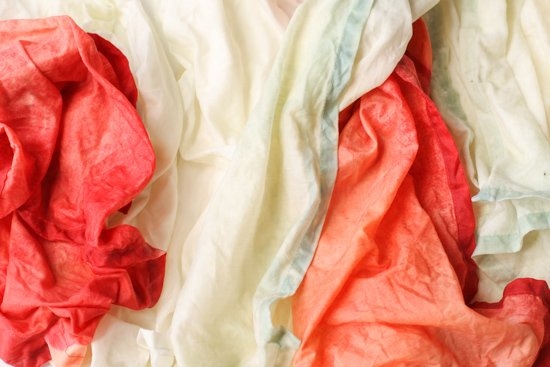 Bleached linen napkins up close, in several colors.