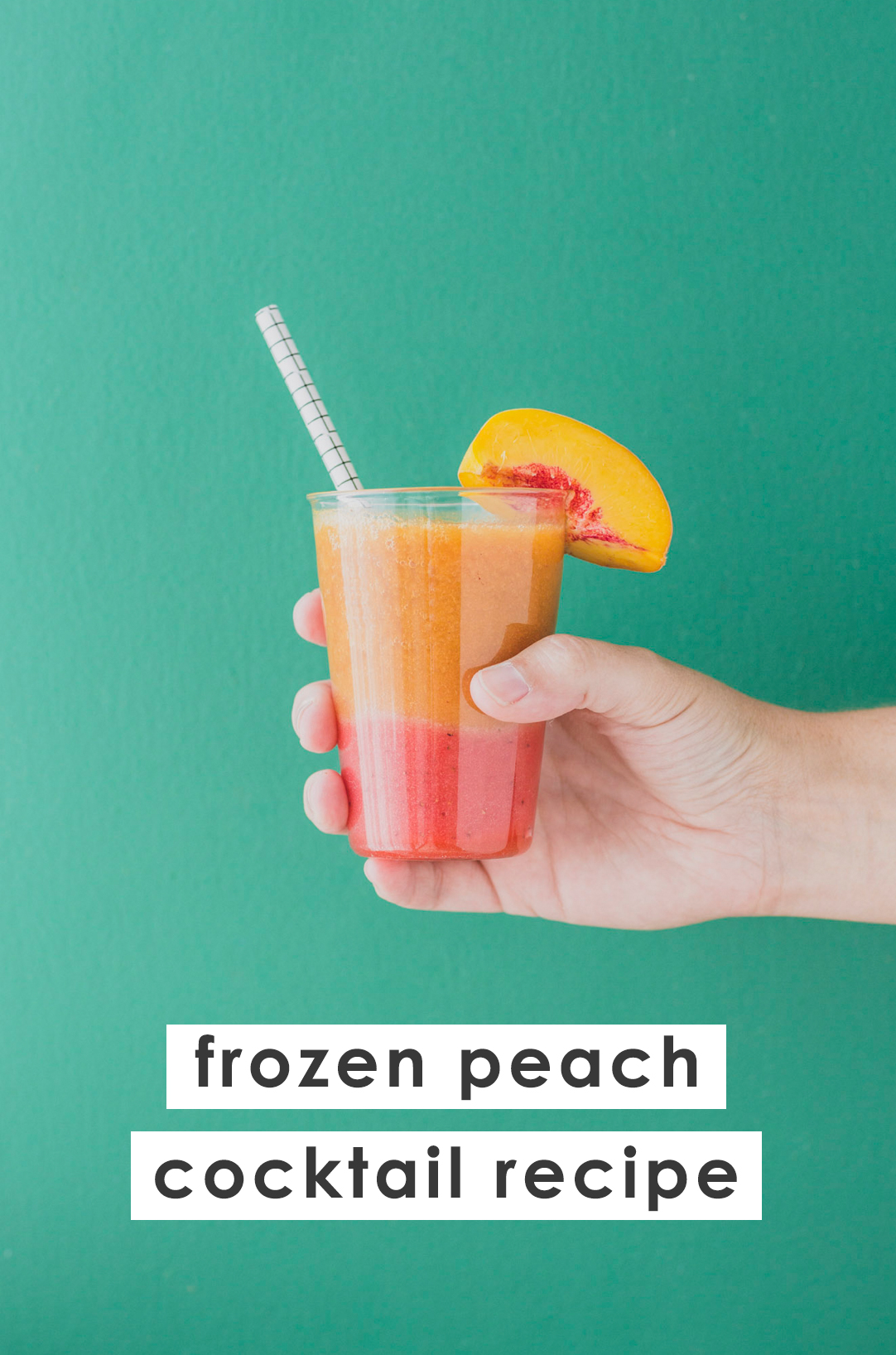 Holding a peach and strawberry color blocked cocktail.