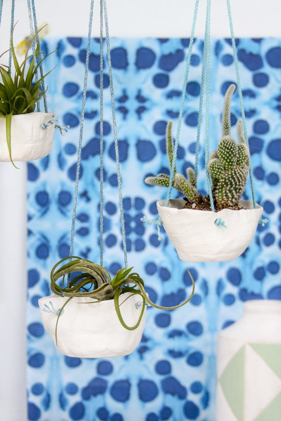 DIY hanging planters using air dry clay and a simple coiling technique. Click through for the full tutorial.