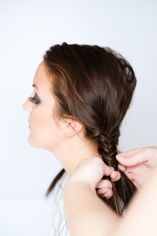 Image of creating fishtail braids for a Wednesday Addams costume.
