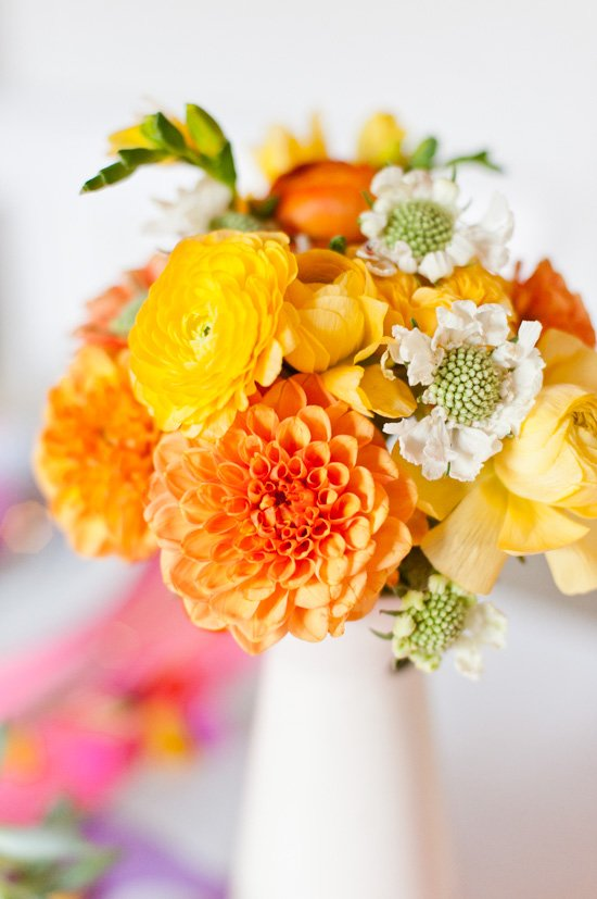 A colorful Thanksgiving centerpiece with ranunculus and dahlias.