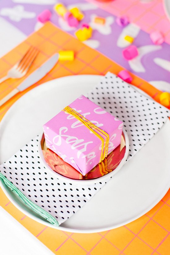 Wrap small gifts in DIY hand lettered name paper and use the gifts as place cards for guests. Great idea for Thanksgiving and Christmas.