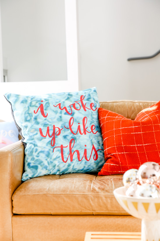Make this hand lettered 'I WOKE UP LIKE THIS' pillow in about an hour with this simple tutorial. Plus, get tips on puling together an effortless holiday look for your living room without spending a ton of time..