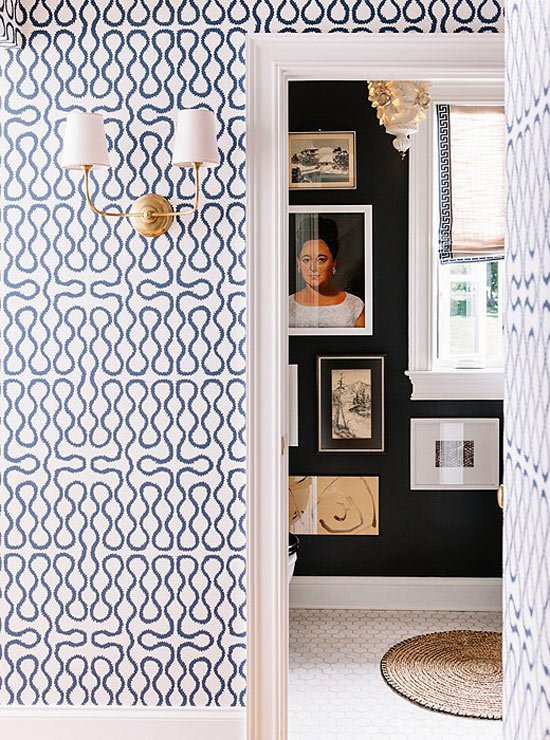 Gold sconce + bold wallpaper
