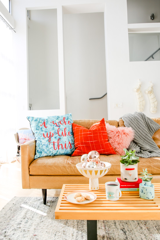 Getting ready for the holidays at home with DIY pillows + cozy textiles. Click through to see how to create this hand lettered #DIY pillow and pull the rest of the room together with additional textiles and accessories.
