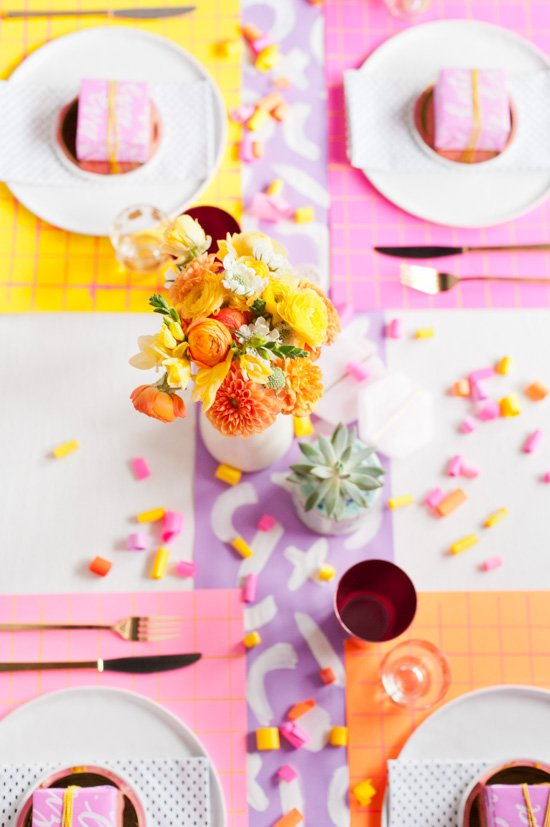 A neon Thanksgiving dinner table