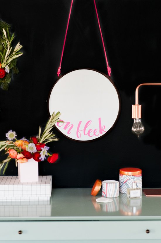 A playful modern take on decorating a vanity for the holidays. Including a hand lettered #diy 'ON FLEEK' vanity mirror.