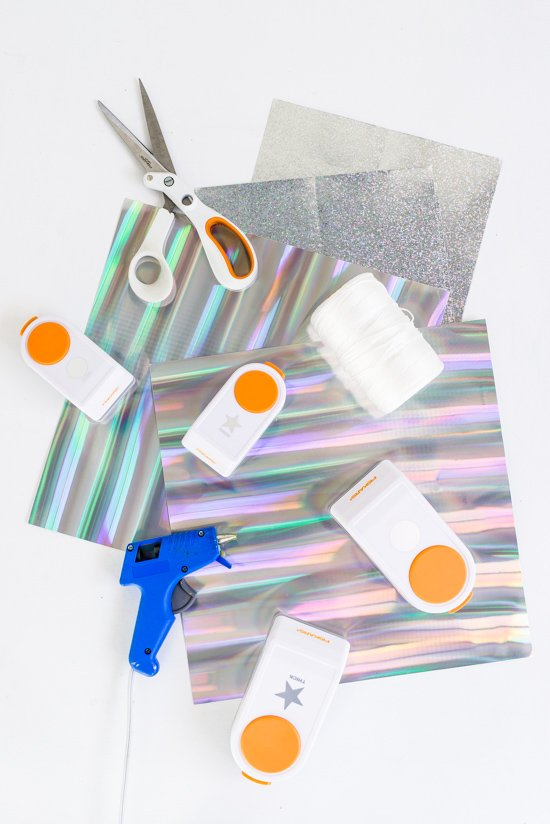 How to Make a Holographic New Year's Eve Garland DIY that Doubles as a Photo Booth Backdrop