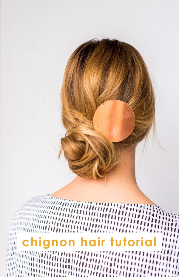 Womens wearing messy chignon hair with copper accessory