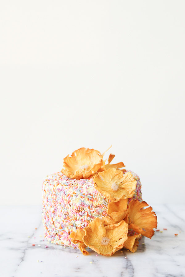 Pineapple flowers on top of a sprinkle cake