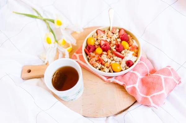 Yogurt and granola breakfast in bed