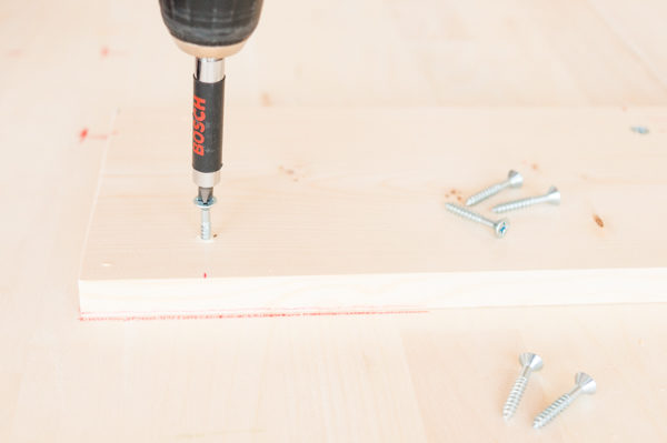 Drilling in the supports for the DIY tables
