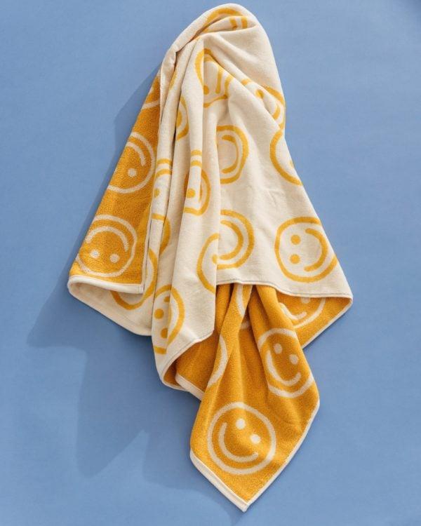 Baggu smiley face beach towel