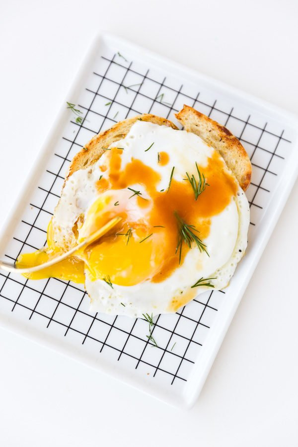 Avocado toast with fried eggs and homemade hot sauce