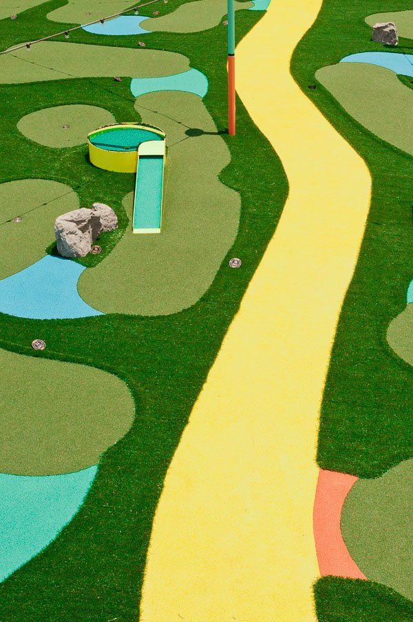 Overhead view of a dayglow mini golf course