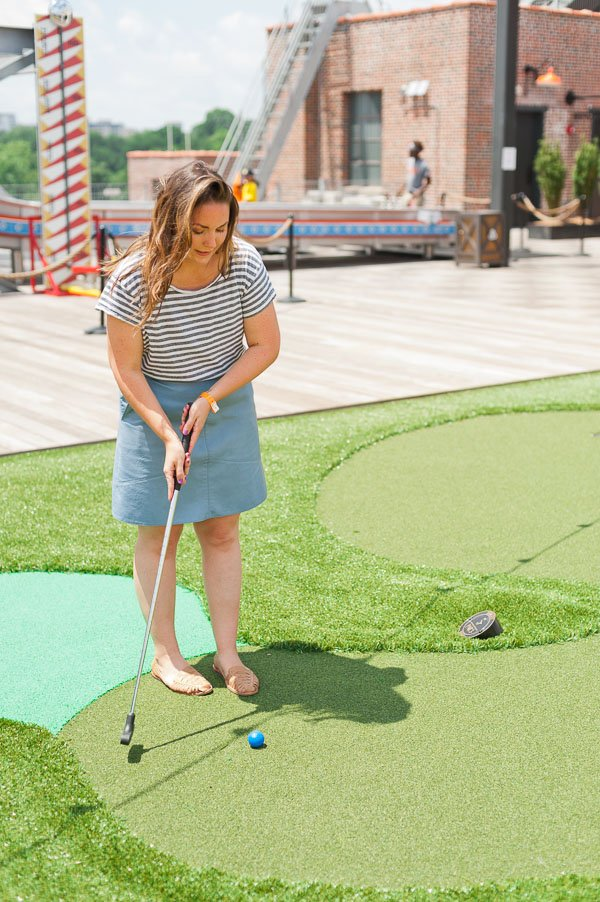 Playing mini golf on a rooftop