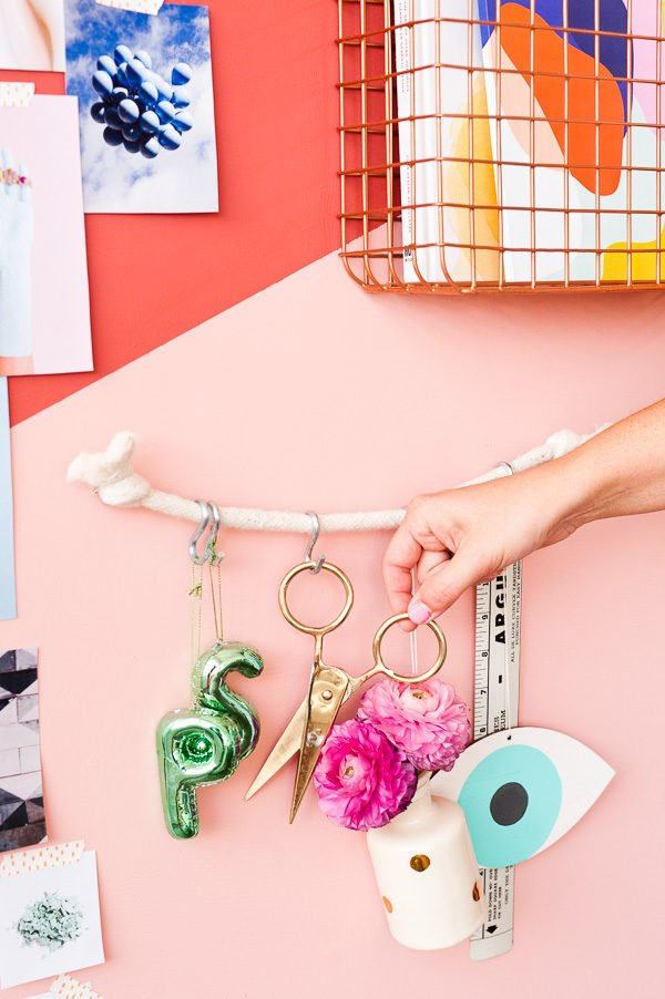 Use rope and 'S' hooks to keep items you use easily accessible. Click through for more DIY organizational ideas like this one.