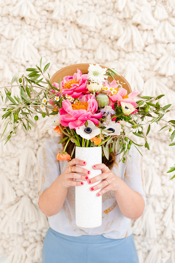 Loving this DIY bouquet of peonies, anemones, and olive branches.