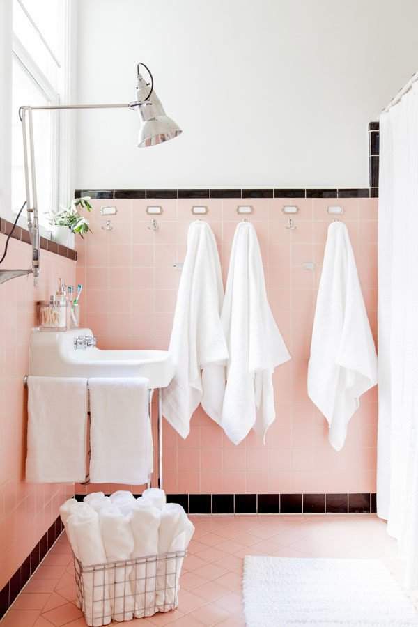 Vintage vibes in the bathroom with pink and black tiles.