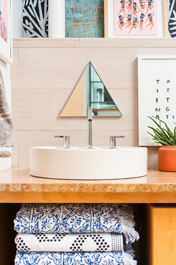 Triangle mirror over the bathroom sink