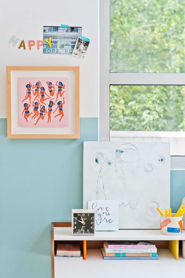 Colorful + bright workspace with lots of windows.