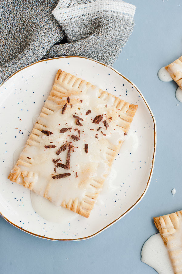 Chocolate + caramel bourbon filled pop tarts with a marshmallow glaze. #recipe