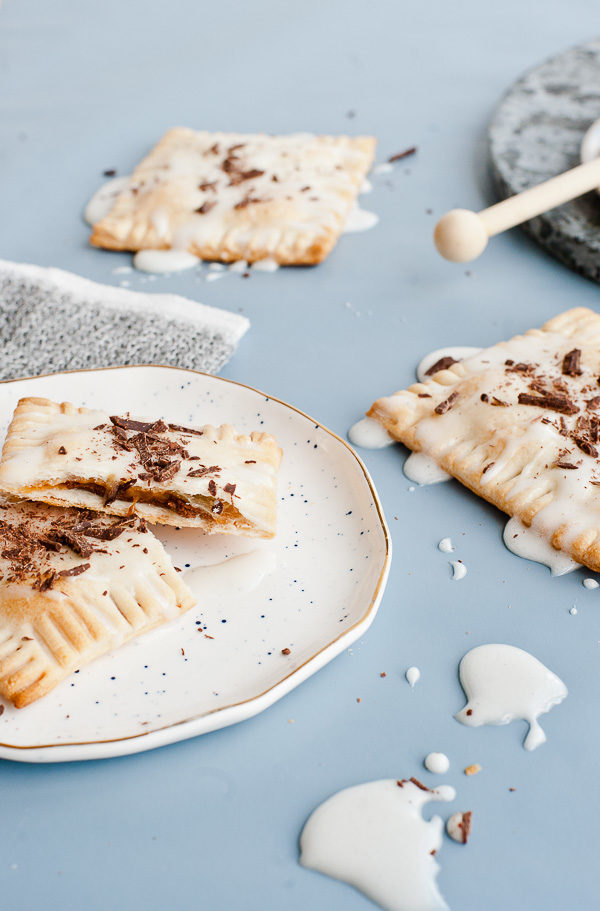 Drunken S'more Pop Tarts. Try this semi-homemade recipe for pop tarts with chocolate + caramel bourbon filling and a marshmallow glaze.