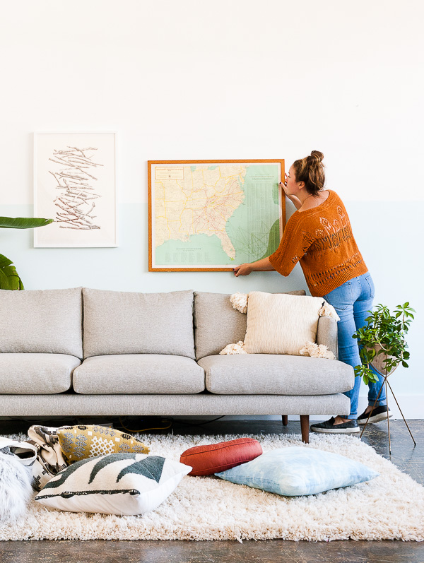 How to style a sofa for fall. Tip #2: Add artwork.