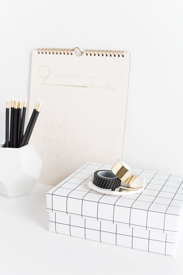 Decorative storage boxes made from black and white grid wallpaper
