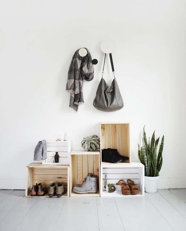 Wood crates stacked on top of one another to create a simple, minimal entryway spot for shoes, bags, etc.