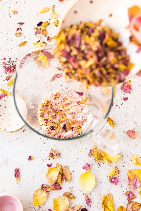 Pour dried rose petals into the salt mixture