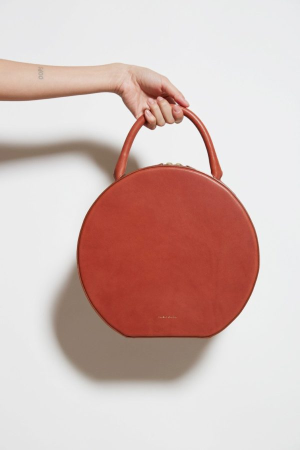 Always into a Mansur Gavriel leather circle bag.