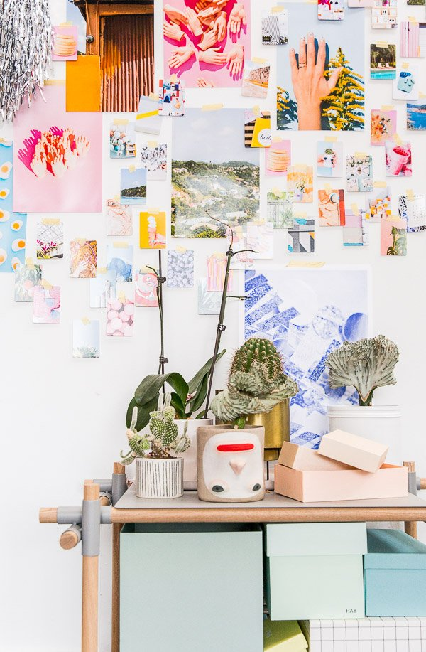 Organized chaos, with colorful prints, planters, and patterned boxes.