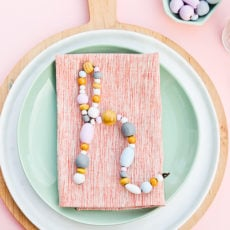 Bead It, Just Bead It: A (Beaded) Monogram Place Setting DIY for Dinner Parties