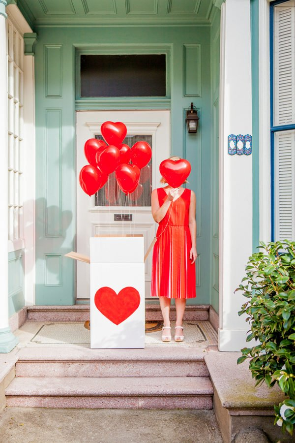 Red heart balloons for a Valentine's Day party in a box