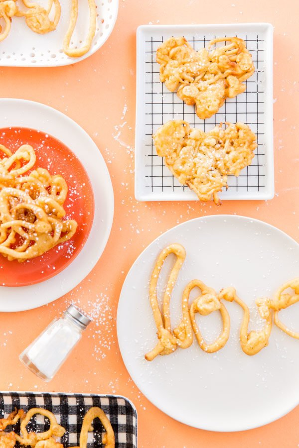 Have fun with funnel cake and this DIY love letter funnel cake recipe idea, for Valentine's Day.