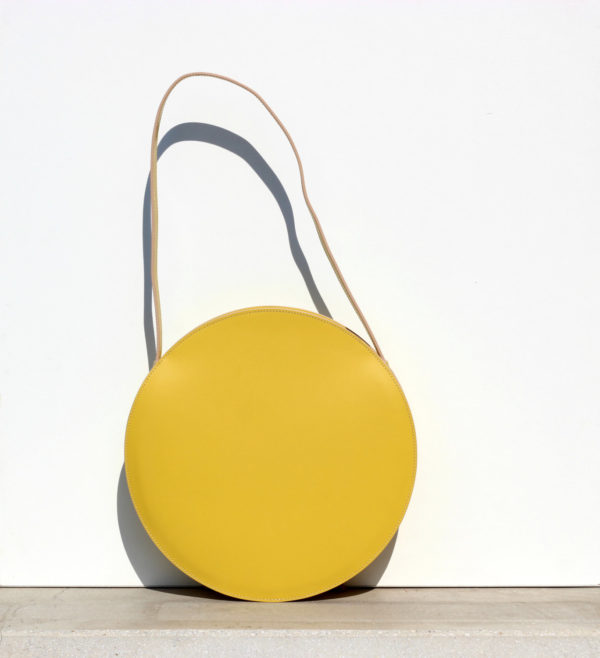 Love this yellow leather circle from BogaBag on Etsy.