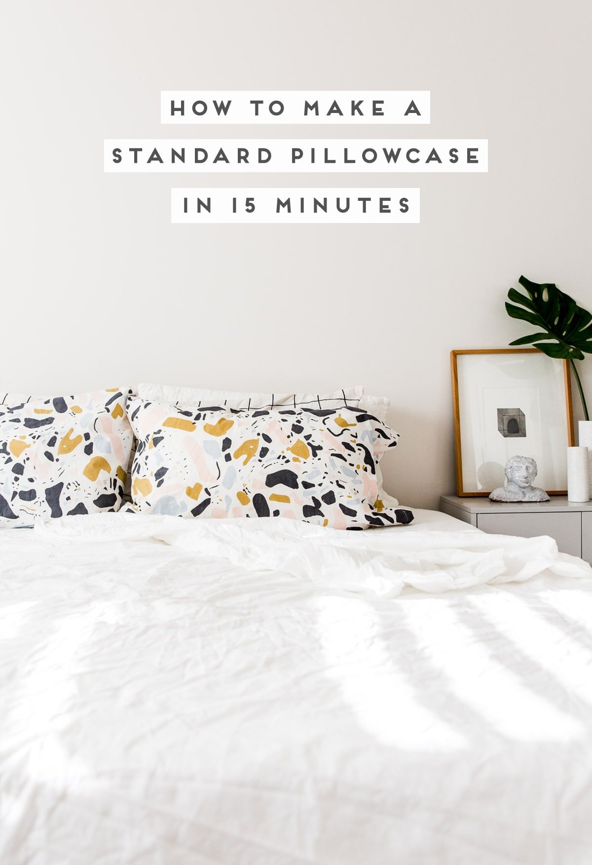 Image of minimal white bedding and bold pattern pillowcases.
