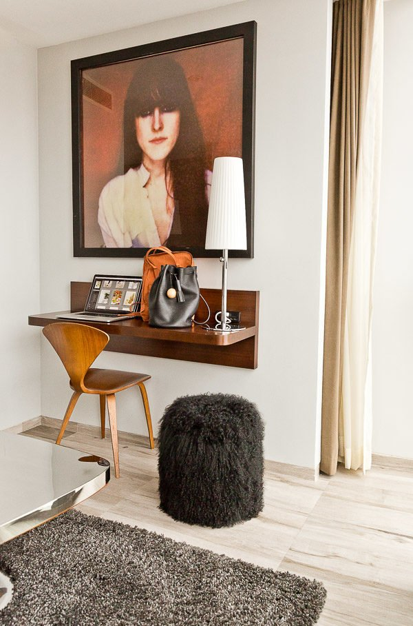 A space-saving desk and a furry pouf at Hotel on Rivington in NYC