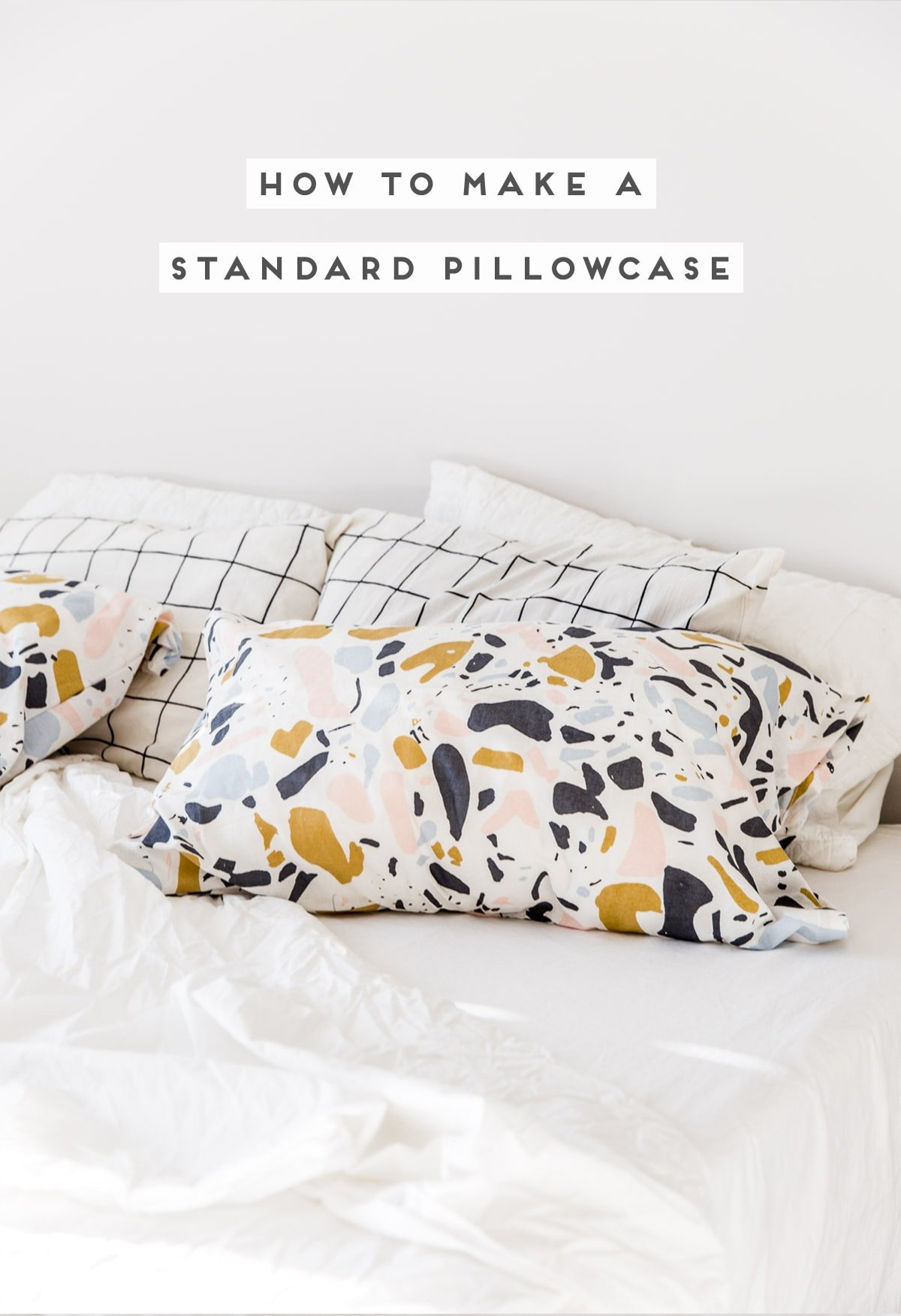 Pattern pillowcases that are handmade, on white bedding.