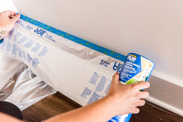 Add painter's plastic to protect baseboards and flooring from paint splatters and spills.