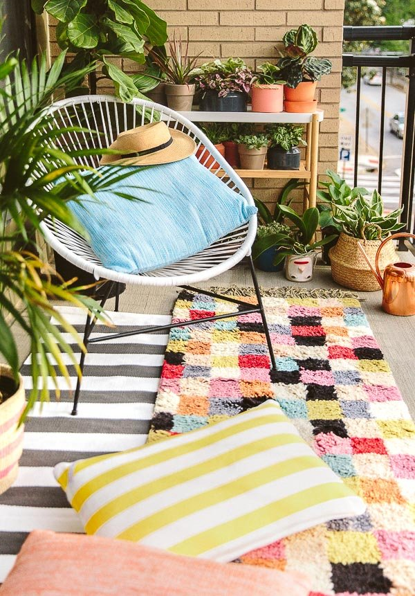 A colorful, eclectic balcony makeover for a small apartment space.