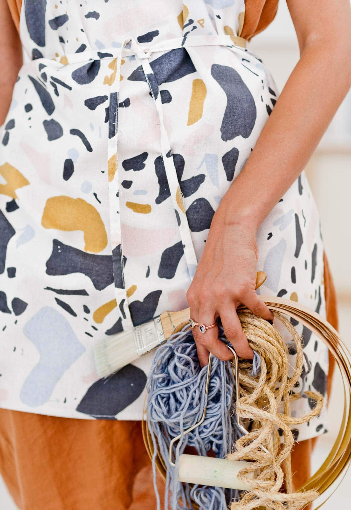Detail photo of terrazzo print apron, made by hand.