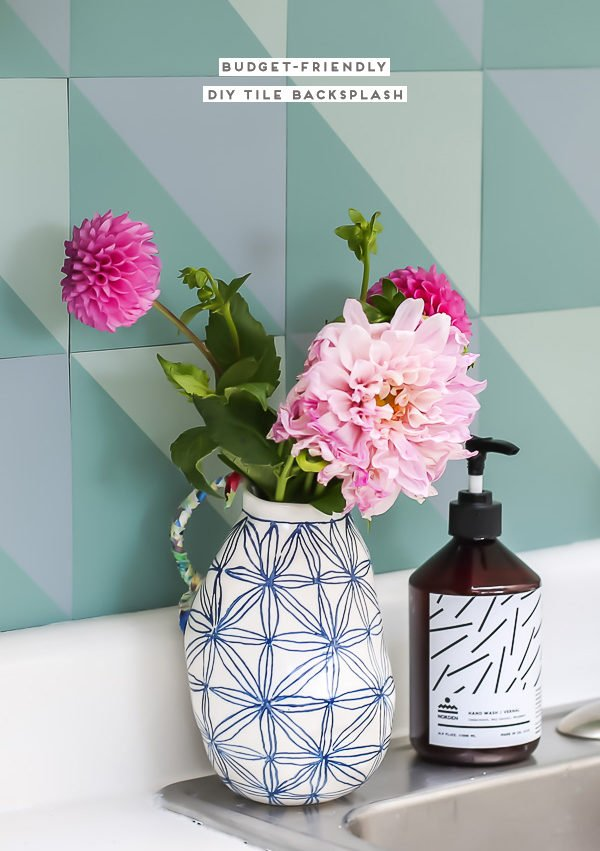 DIY budget backsplash for under $50! Click through for the step by step tutorial and before and after kitchen photos.