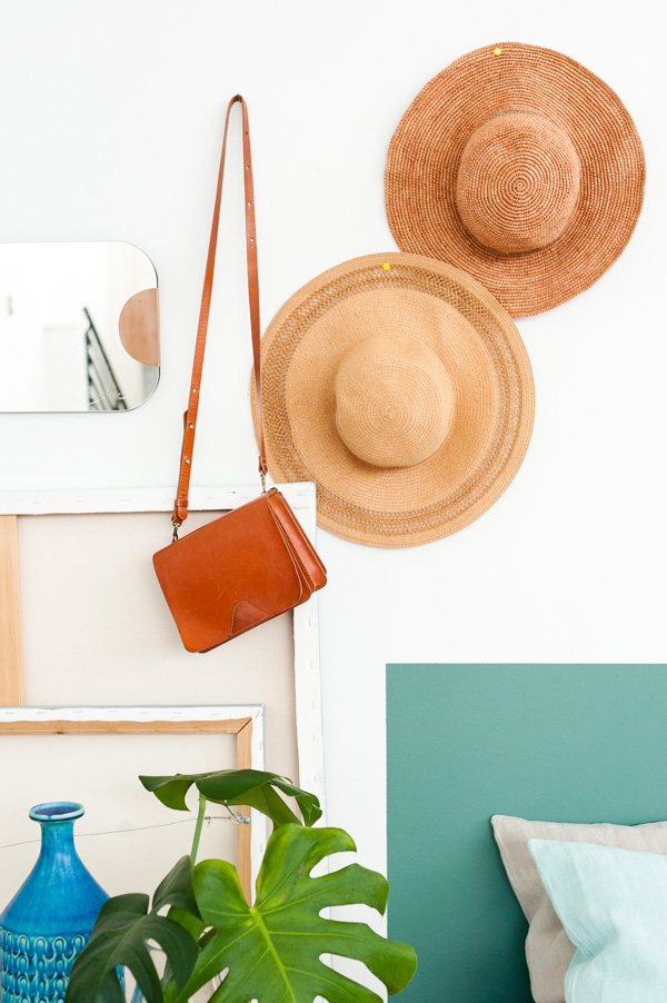 Hang hats and purses on the wall as decoration