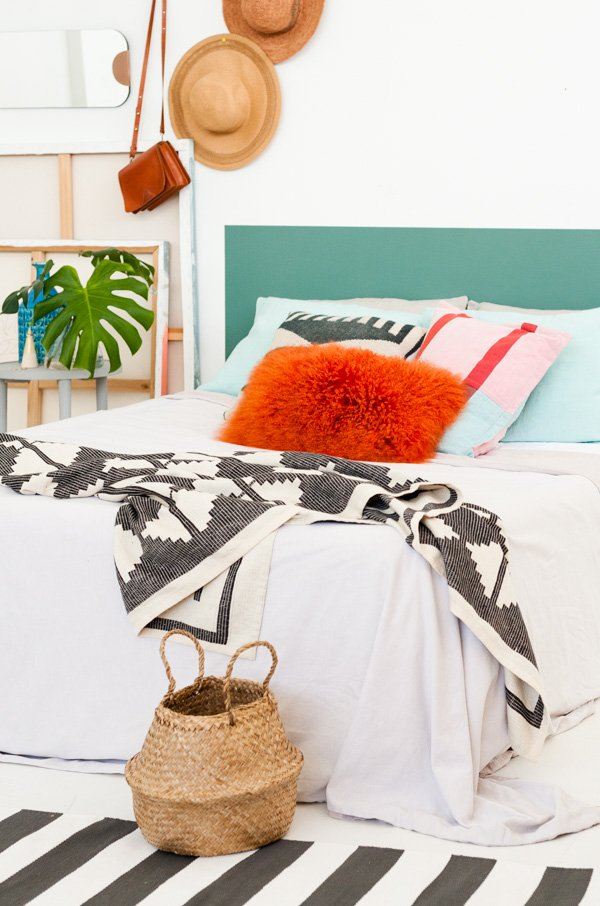 An eclectic modern bedroom with DIY headboard. Click through for the video tutorial.