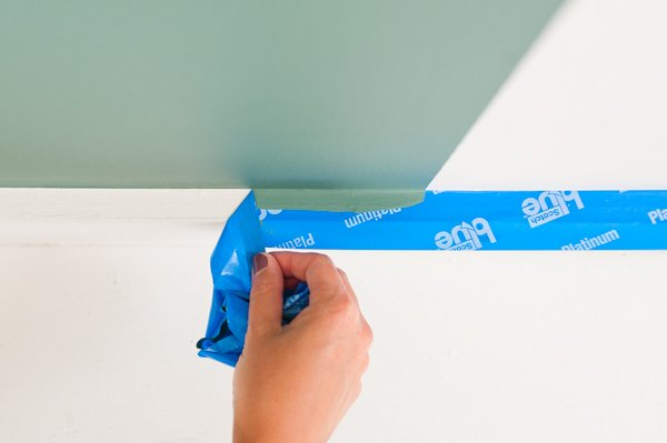 Remove painter's tape for clean lines at baseboards
