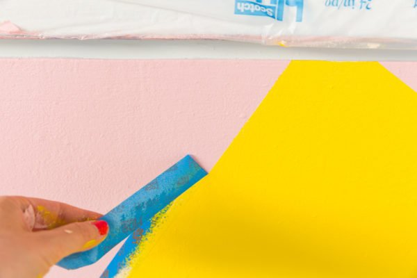 A colorful DIY mural in an entryway