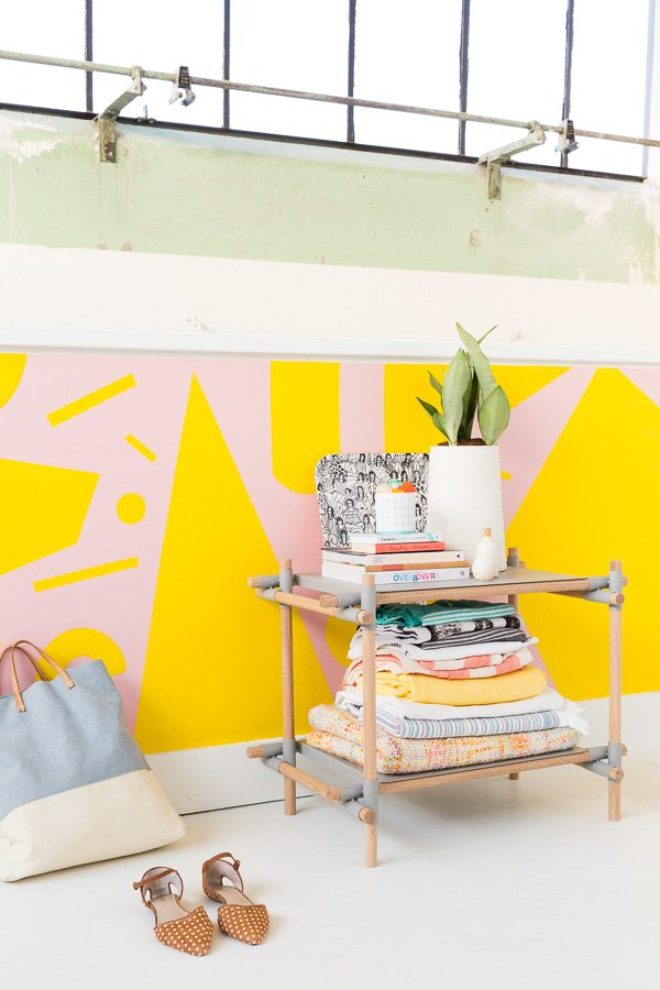 A pink and yellow geometric mural. Click through for the step by step process.