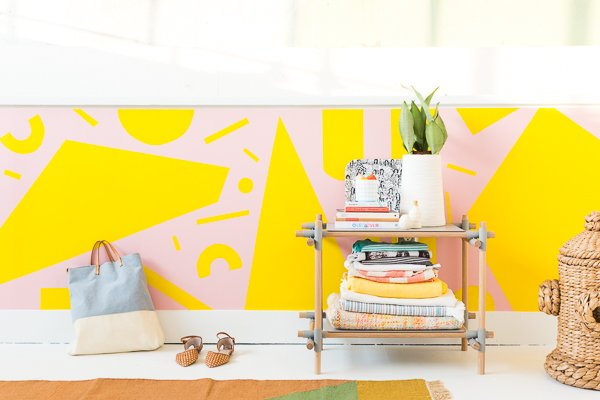 Pink and yellow. A colorful DIY mural in an entryway.